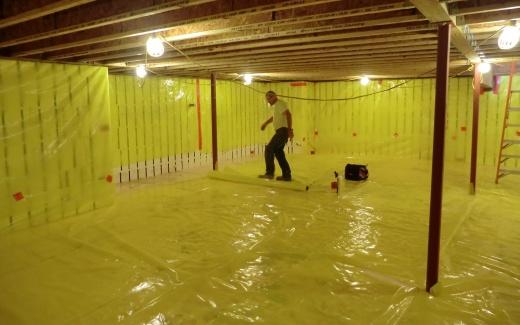 Bill from Hanneman and Fineis Concrete installs vapor barrier