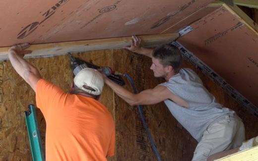 Bill and Matt installing air barrier framing