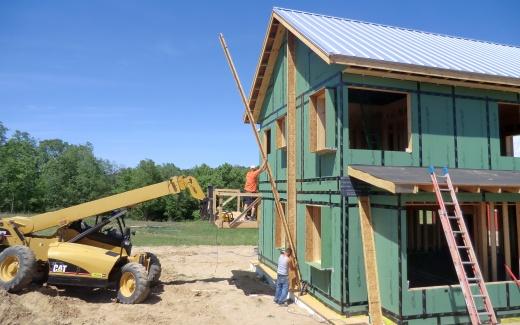 Raising vertical truss