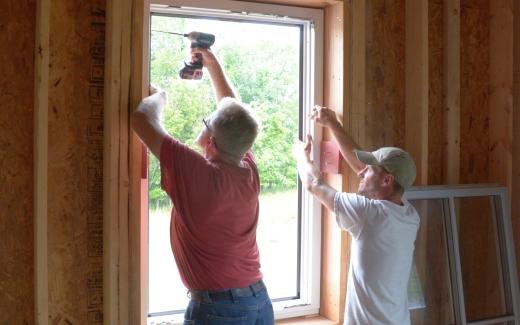 Michael and Matt installing window frame