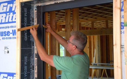 Michael installing front door