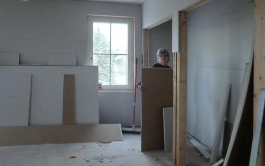 Friend Pat helping with drywall cleanup