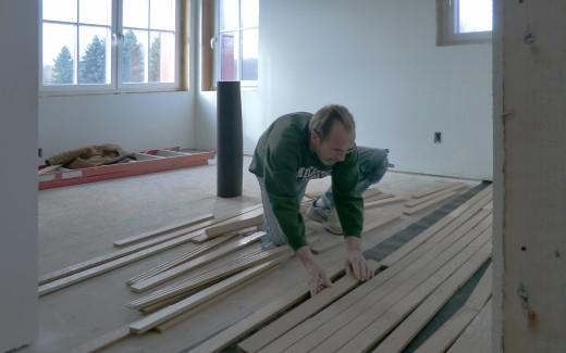 Lee installing floor in guest bedroom