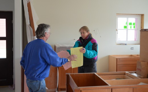 Bob Hewson and Maura discussing tiles