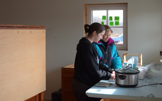 Laura and Maura preparing a lunch for the work crew