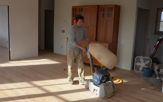 Larry Zalesny sanding kitchen floor