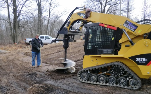 Brad and Bryan digging hole with auger