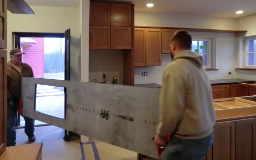 Counter top being carried in by Dustin and Don