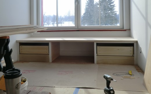 Window seat in kitchen with dog bed area in middle