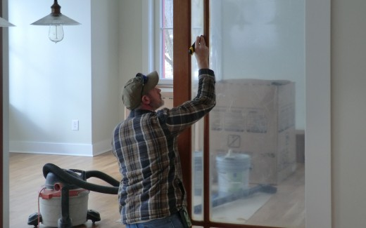 Dave cleaning trim on pocket doors between kitchen and parlor